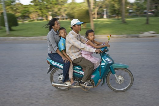 Siem Reap,Cambodia;Family riding on a scooter together without safety helmets : Stock Photo