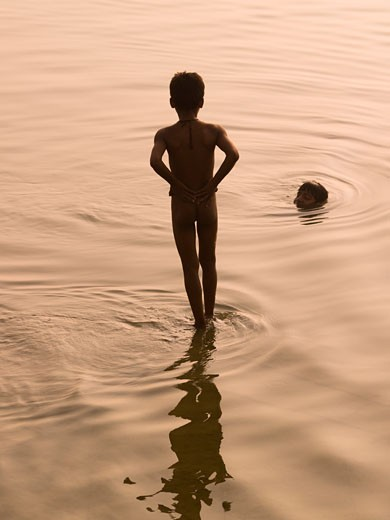 Stock Photo: 1889-43815 The Ganges,Varanasi,India;Boys bathing in the river