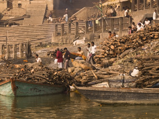 The Ganges,Varanasi,India;Boats full of timber in the river : Stock Photo