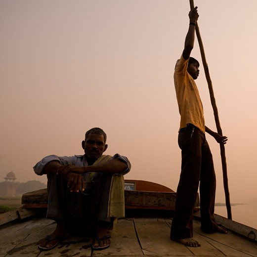 Agra,India;Men on a boat at sunset : Stock Photo
