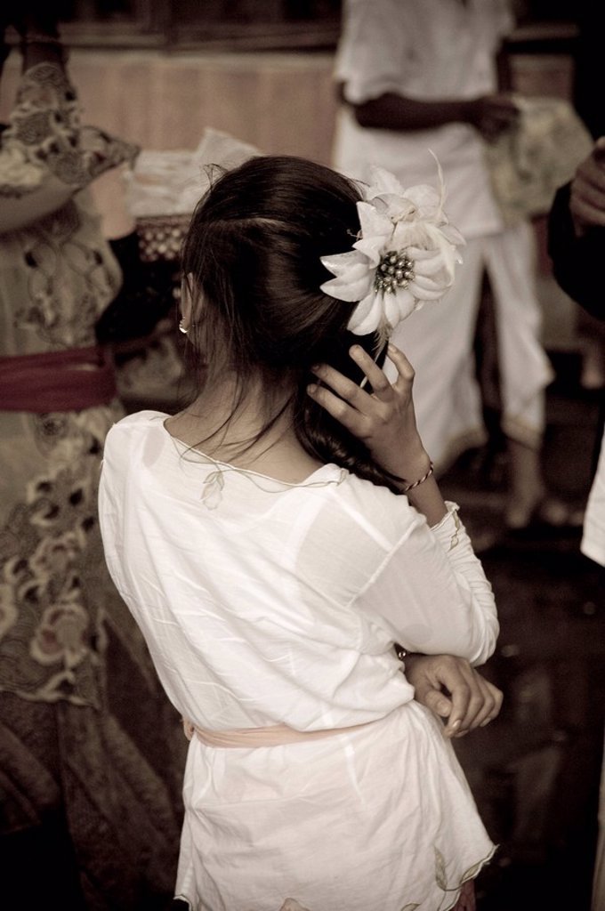 Young girl with flower in hair at Pura Pulaki : Stock Photo