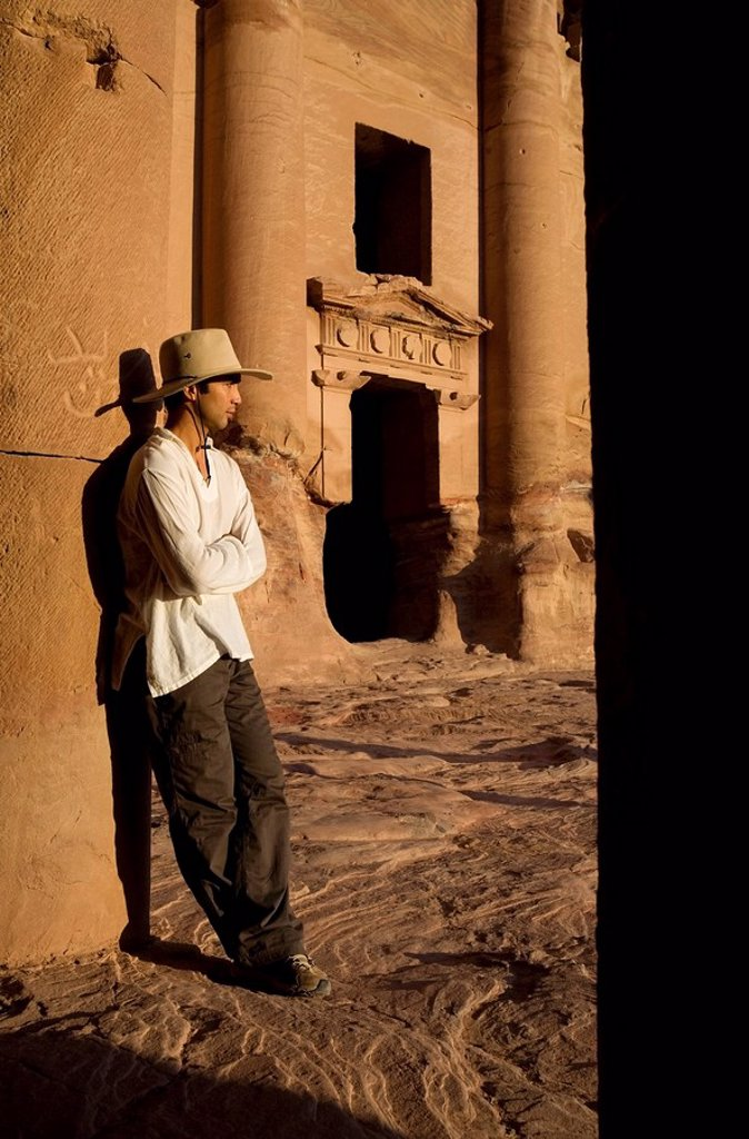 Man standing by royal tomb in Petra : Stock Photo
