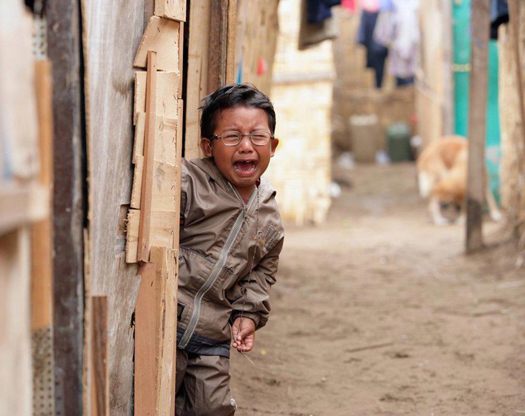 Young boy crying, Lima, Peru : Stock Photo