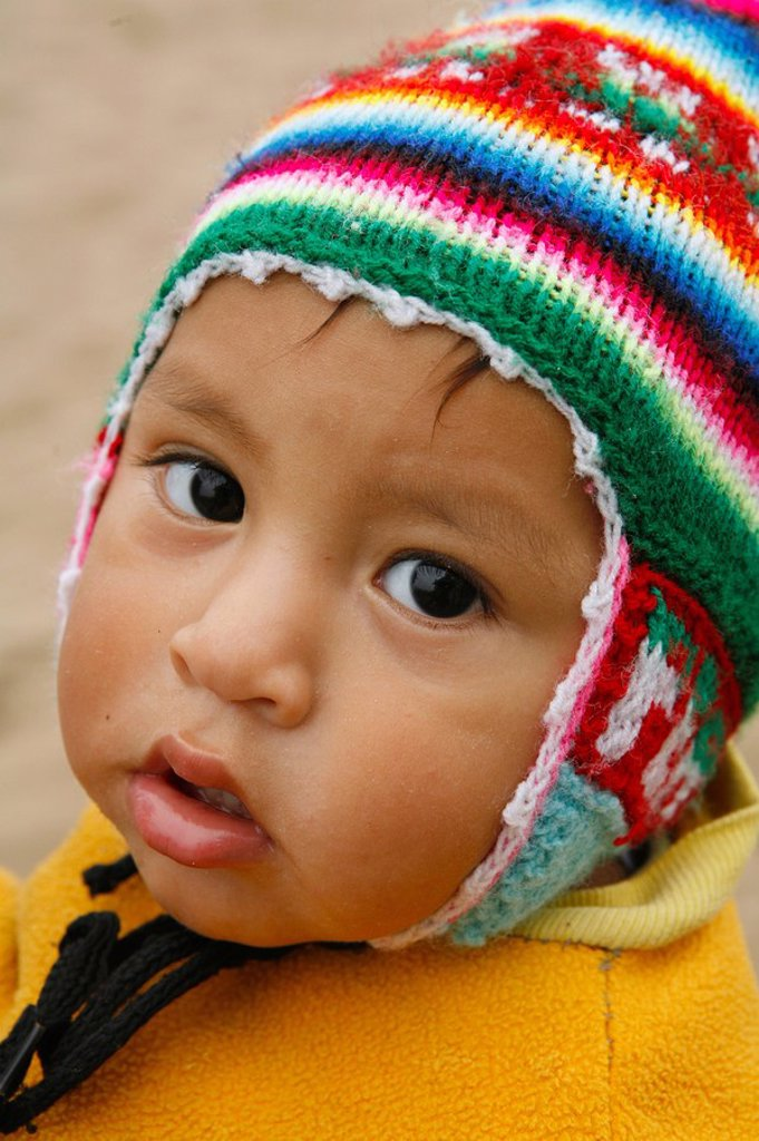 Stock Photo: 1889-45284 Young child in wool cap, Lima, Peru
