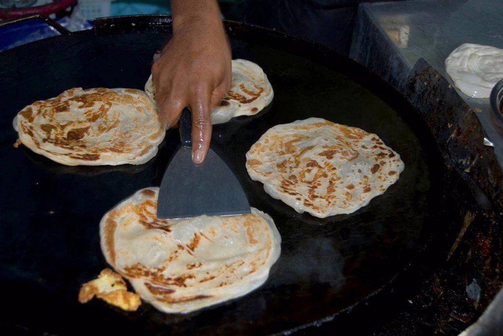 Kuala Lumpur, Malaysia, A Person Making Pancakes : Stock Photo