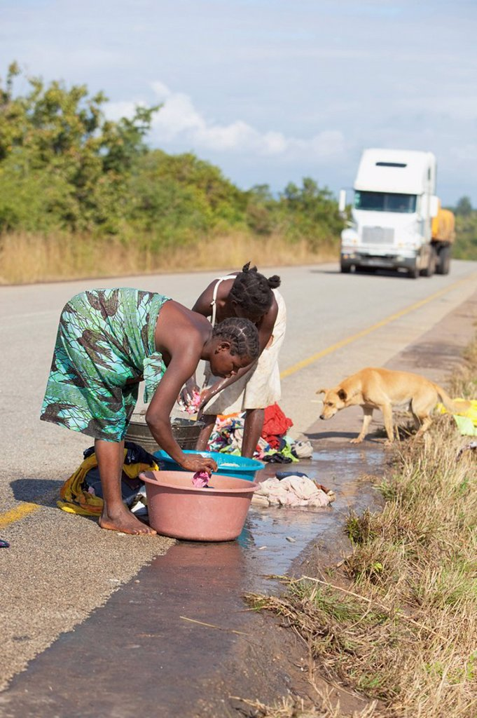 women doing laundry on the side of the road, manica, mozambique, africa : Stock Photo