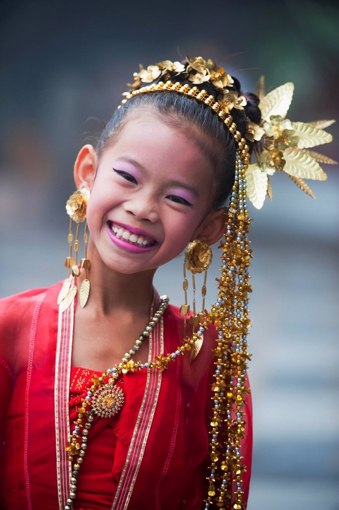 Stock Photo: 1889-57182 Young Thai Girl Performs Traditional Dance At Doi Sutep Temple, Chaing Mai, Thailand