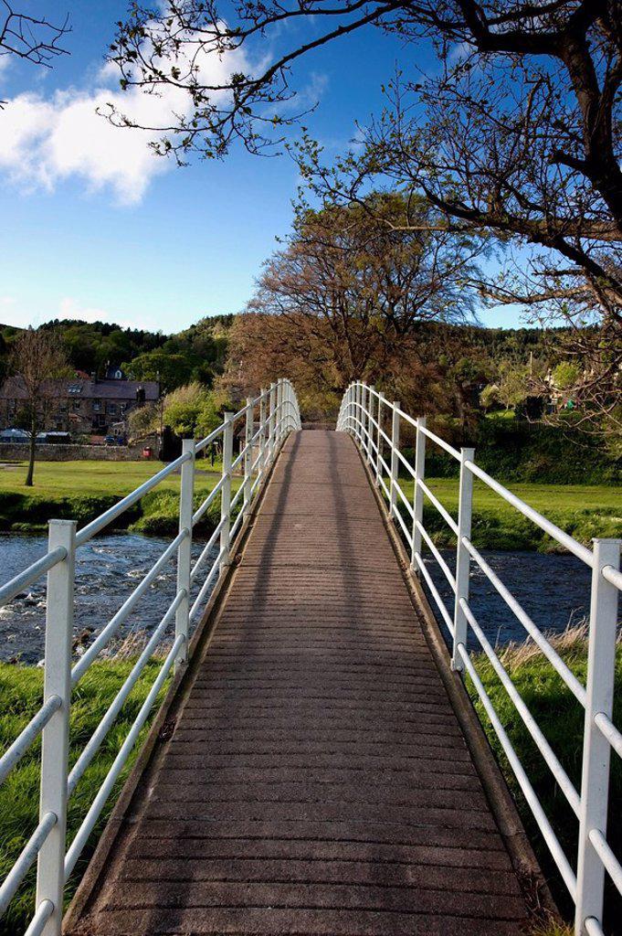 Pedestrian bridge, Rothbury, Northumberland, England : Stock Photo
