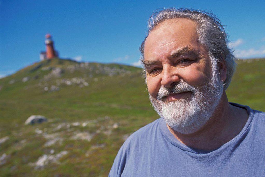Man at lighthouse, Trespassey, Newfoundland, Canada : Stock Photo