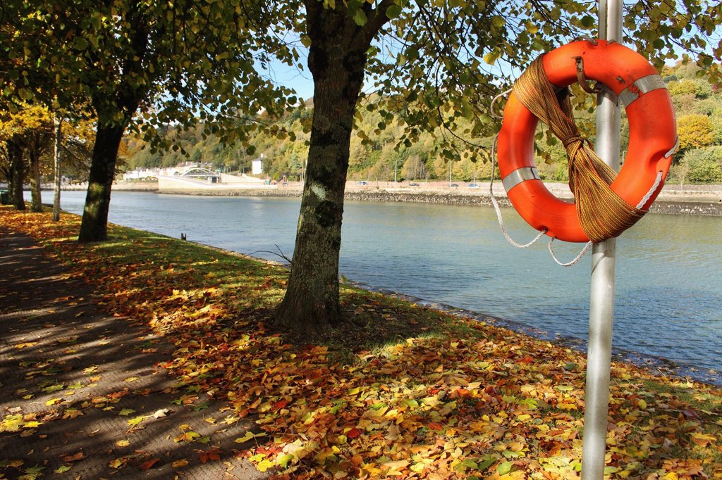 life buoy by the river lee in munster region, cork city, county cork, ireland : Stock Photo