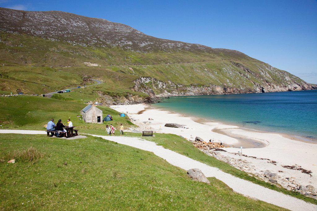 enjoying the seashore, keem beach, achill island, county mayo, ireland : Stock Photo