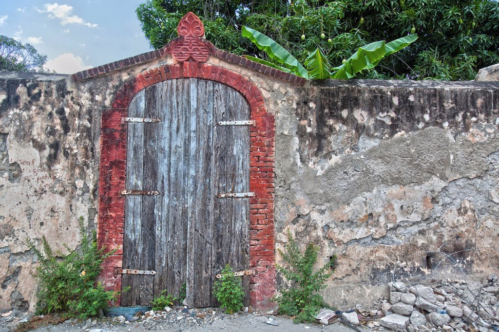 Stock Photo: 1889-63451 an old wooden gate in a stone wall, jacmel, haiti