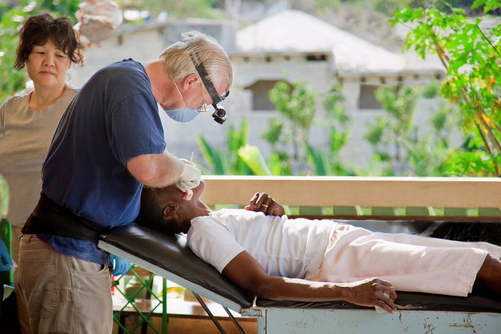 Stock Photo: 1889-63505 a dentist volunteers his dentistry to help haitians living in poverty, grand saline, haiti