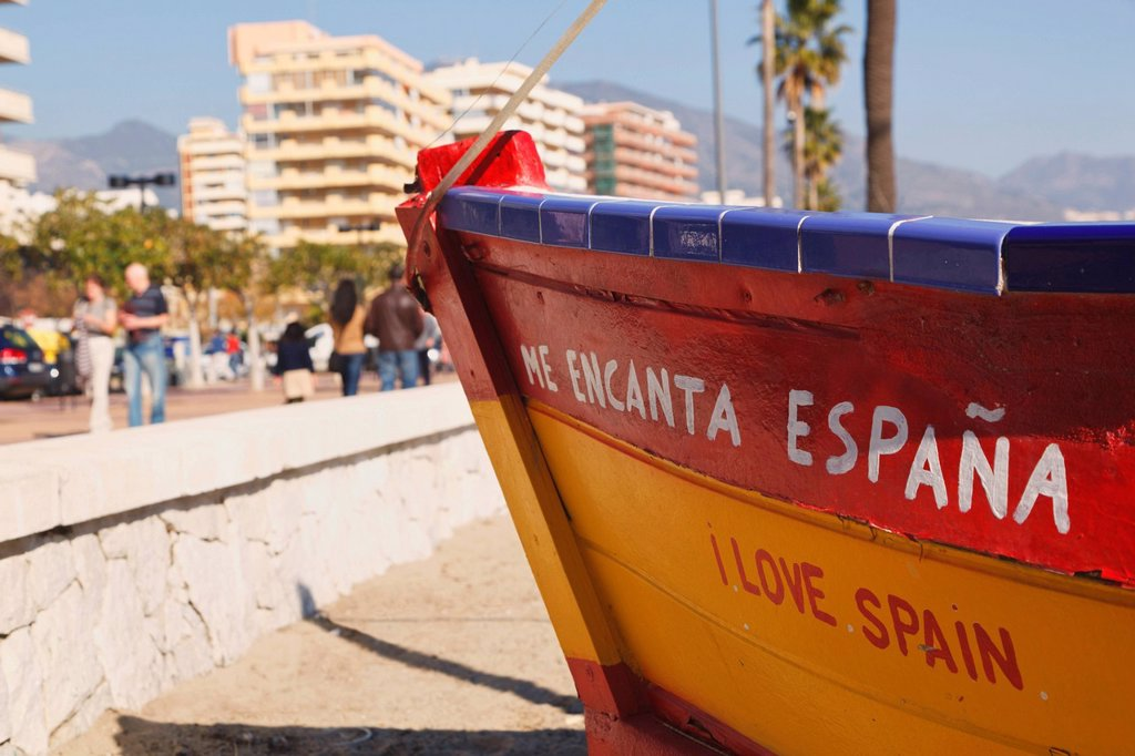 fishing boat on beach with slogan me encanta espana, or i love spain, los boliches, fuengirola, malaga province, costa del sol, spain : Stock Photo