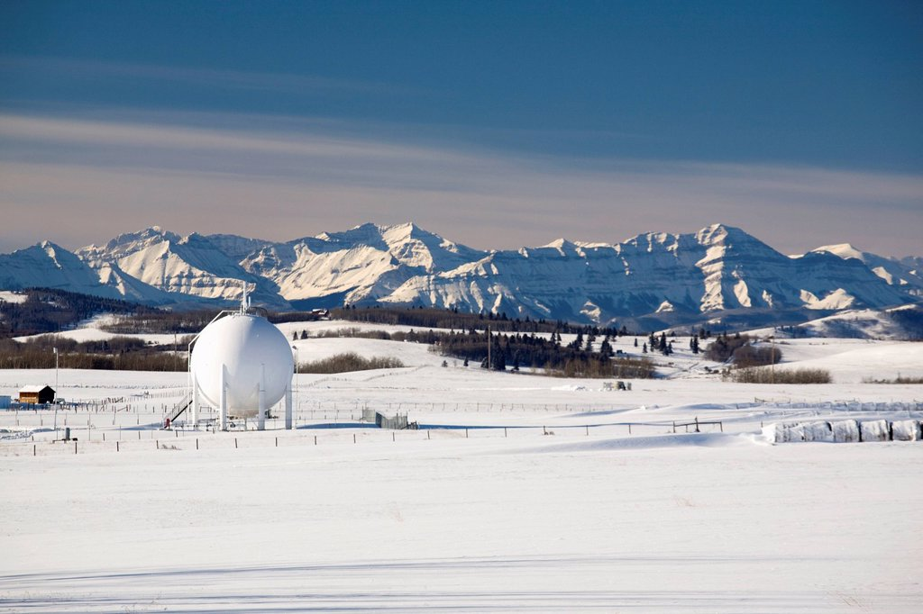 Stock Photo: 1889-65311 spherical oil tank in a snow_covered field, longview, alberta, canada