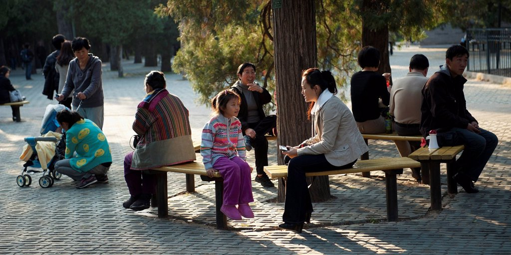 Stock Photo: 1889-65868 people relaxing outside the temple of heaven, beijing, china