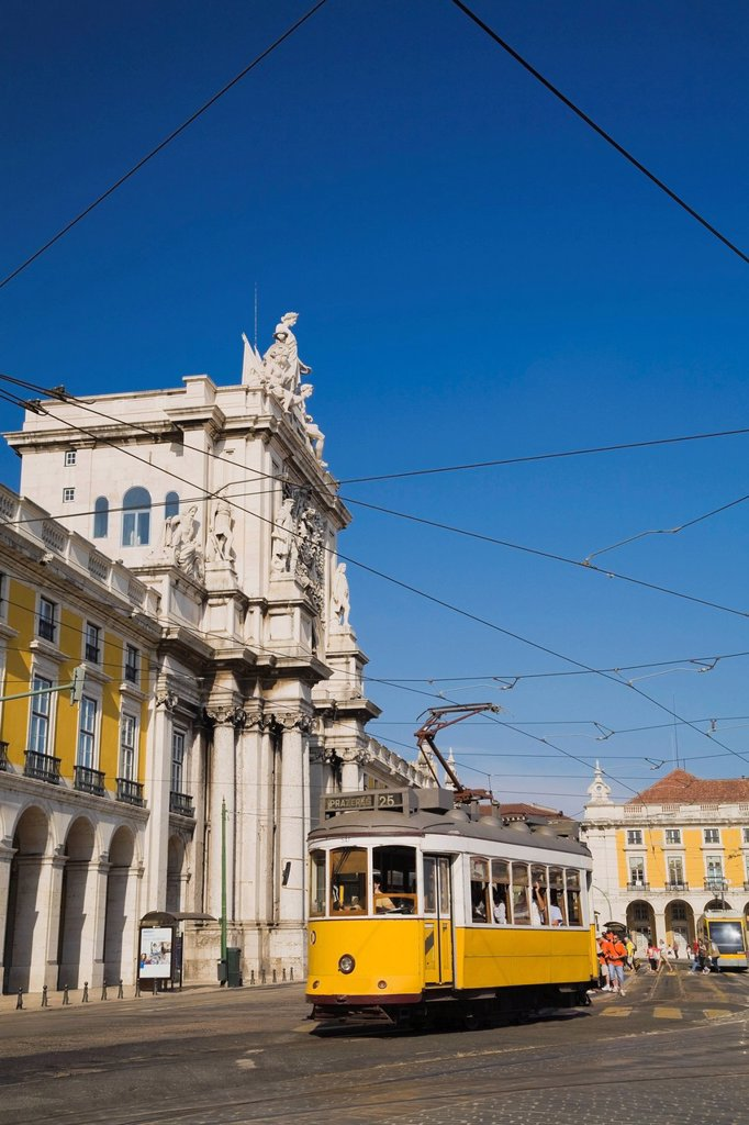 electric trolley in front of the rua augusta arch, lisbon, portugal : Stock Photo