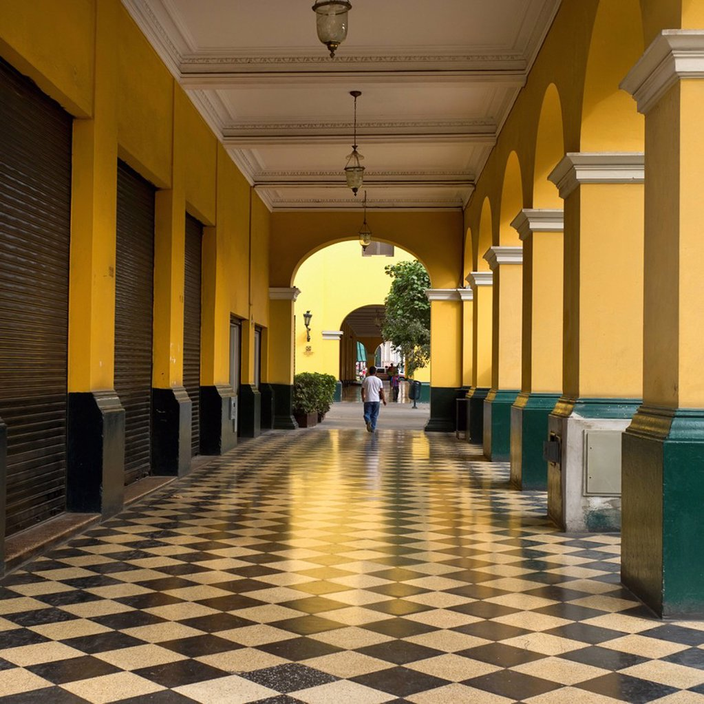 a man walks down the corridor in the historic centre of lima, lima peru : Stock Photo