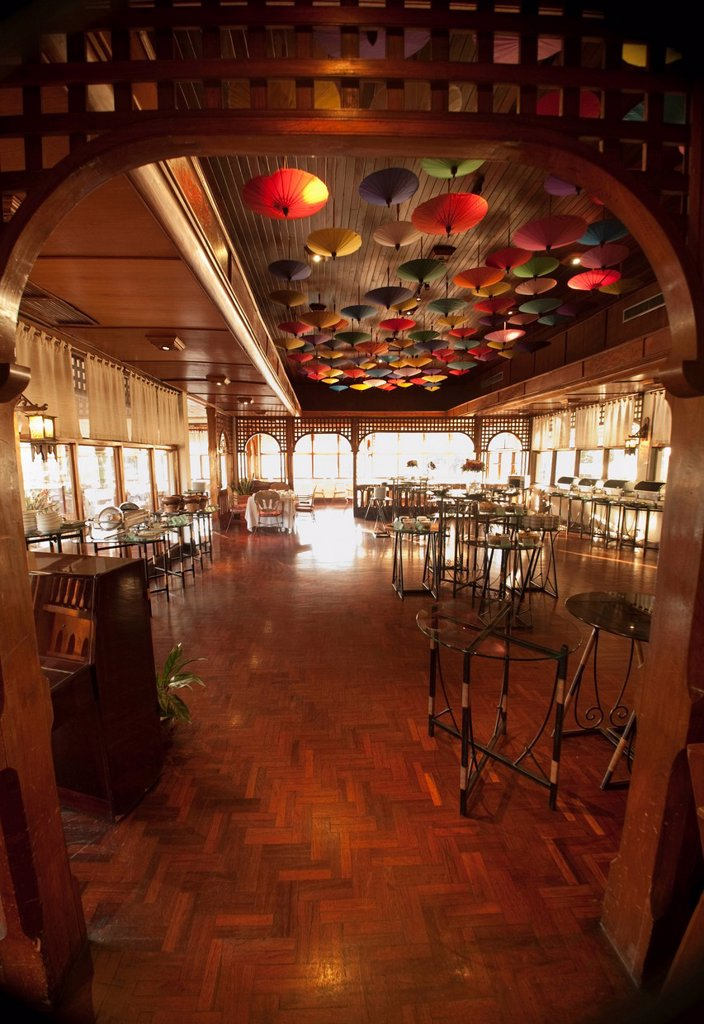umbrellas hanging from the ceiling at the restaurant in amari rincome hotel, chiang mai thailand : Stock Photo