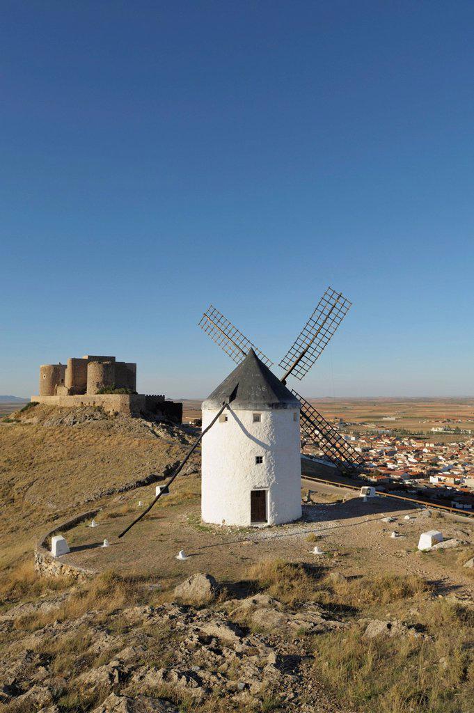 12th century castle and windmills of la mancha, consuegra spain : Stock Photo