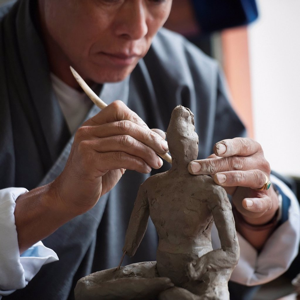 Art Student Sculpting A Clay Figure In National Institute Of Zorig Chusum, Thimphu Bhutan : Stock Photo