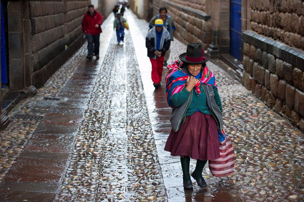People Walking Up The Wet Street, Cusco Peru : Stock Photo