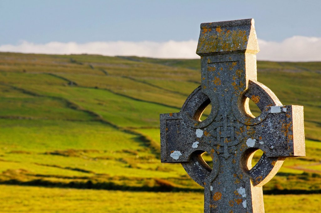 celtic cross in a cemetery in the burren region, fanore county clare ireland : Stock Photo