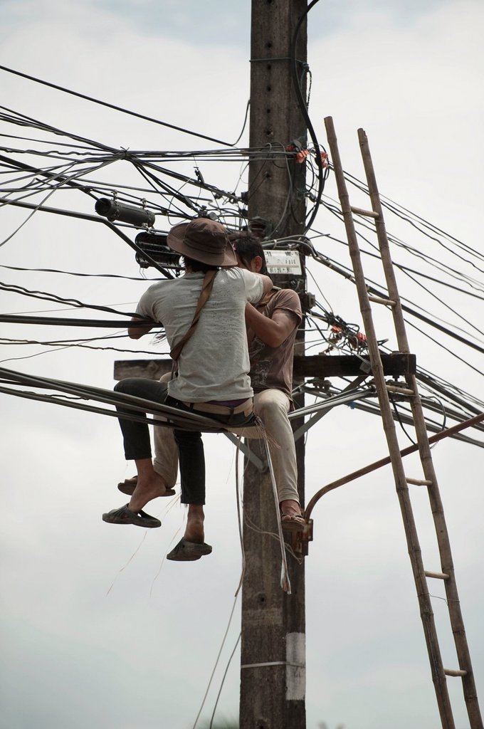 Stock Photo: 1889-72696 technicians working on the wires, mae sot thailand