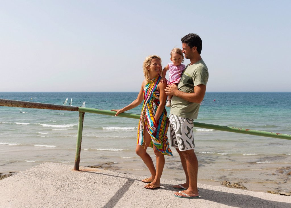 a mother and father with their young daughter at the coast, tarifa cadiz andalusia spain : Stock Photo