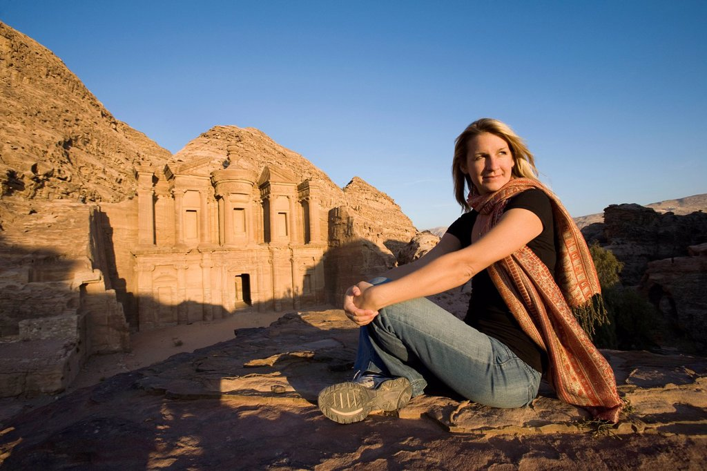 Stock Photo: 1889-74671 A Woman Tourist Visits The Nabatean Ruins Of The Monastery, Petra Jordan