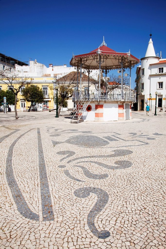 Stock Photo: 1889-74752 Designs In The Tiled Ground In The Town Square, Faro Algarve Portugal