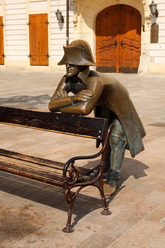 Stock Photo: 1889-74919 Bronze statue of a soldier leaning on a bench in front of the french embassy, bratislava slovakia