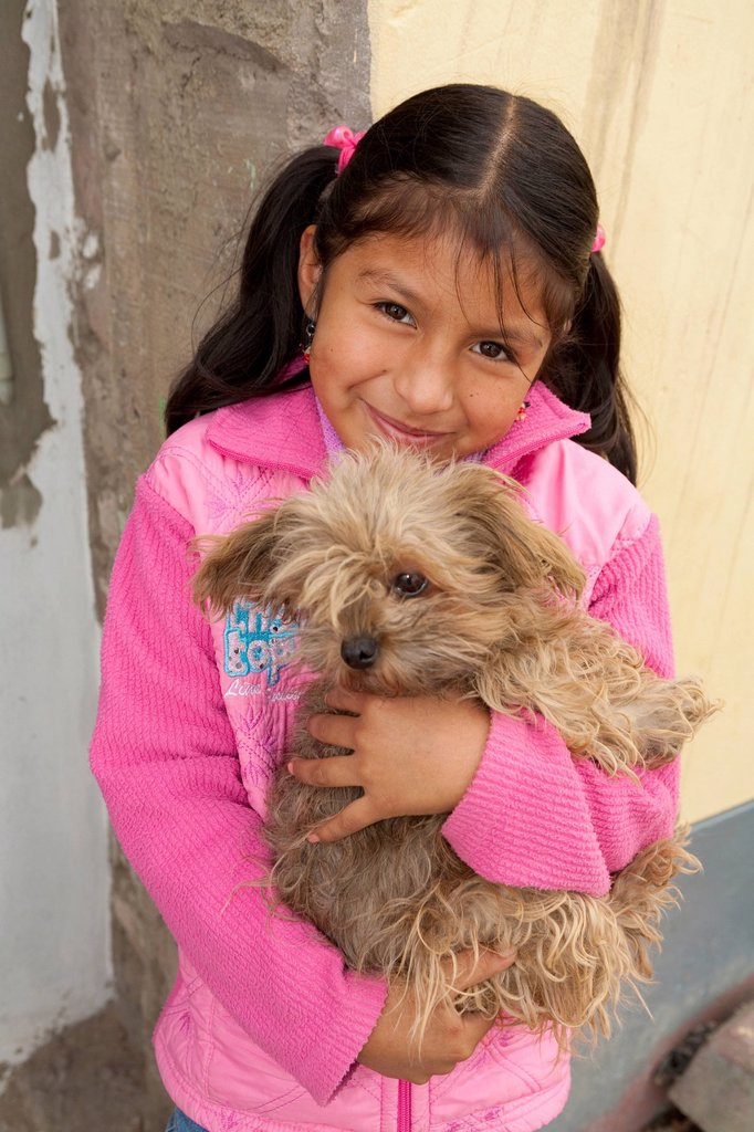 A girl with her pet dog, lima peru : Stock Photo