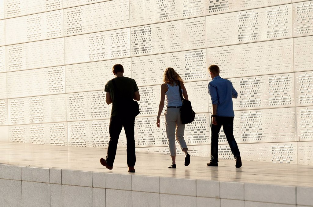 Three Adults Walking By Oslo Opera House, Oslo Norway : Stock Photo