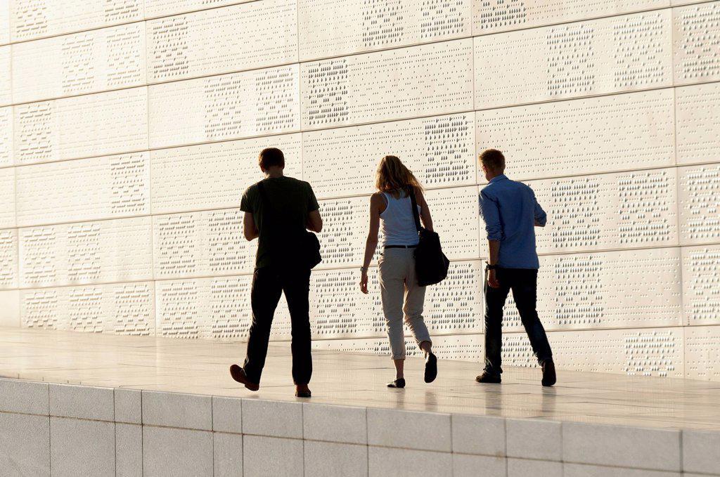 Stock Photo: 1889-75458 Three Adults Walking By Oslo Opera House, Oslo Norway