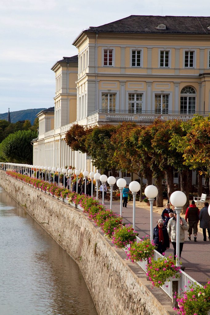 Stock Photo: 1889-75568 Pedestrians walking on the promenade along the river lahn, bad ems rheinland_pfalz germany