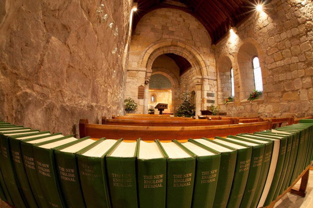 Stock Photo: 1889-76029 A Row Of The New English Hymnals At The Back Of A Sanctuary, Northumberland England