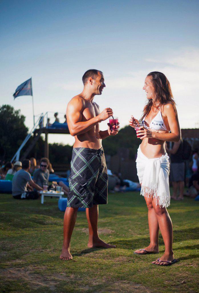 A Young Man And Young Woman Talking At A Beach Bar, Tarifa Cadiz Andalusia Spain : Stock Photo