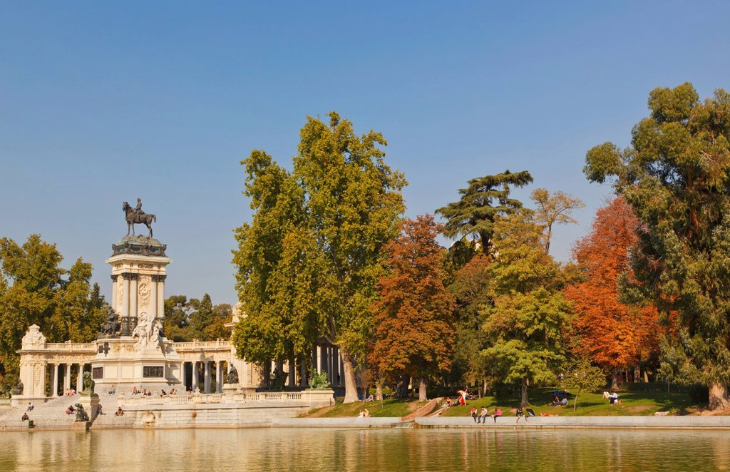 Stock Photo: 1889-76804 The lake in el retiro gardens with the monument to king alfonso xii in background, madrid spain