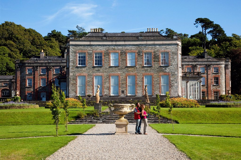 Stock Photo: 1889-76927 A couple stands on a path in the gardens at bantry house, bantry county cork ireland