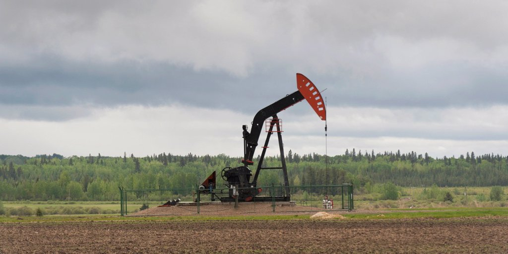 Stock Photo: 1889-79611 a pumpjack on an oil well, alberta canada