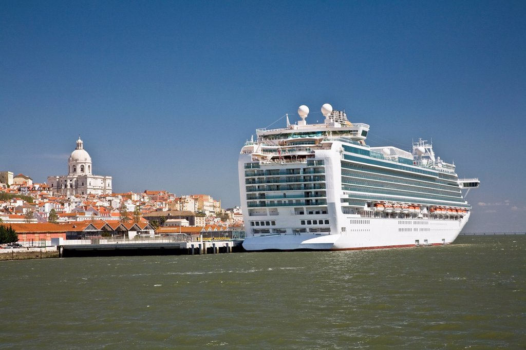 a cruise ship moored with the church of santa engracia in the background, lisbon, portugal : Stock Photo
