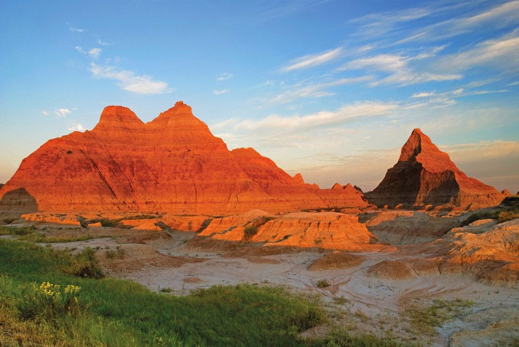 Stock Photo: 1889-79880 a red sunrise illuminates the hills in badlands national park, dakota united states of america