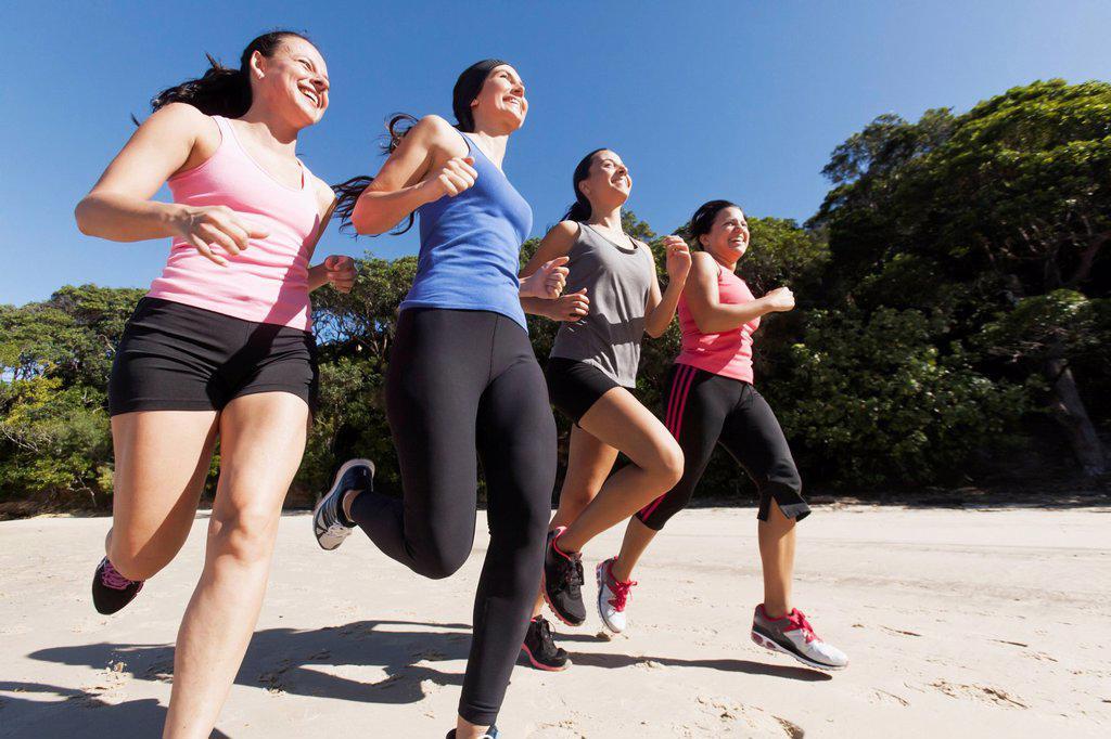 Stock Photo: 1889-81229 Four women running, gold coast queensland australia