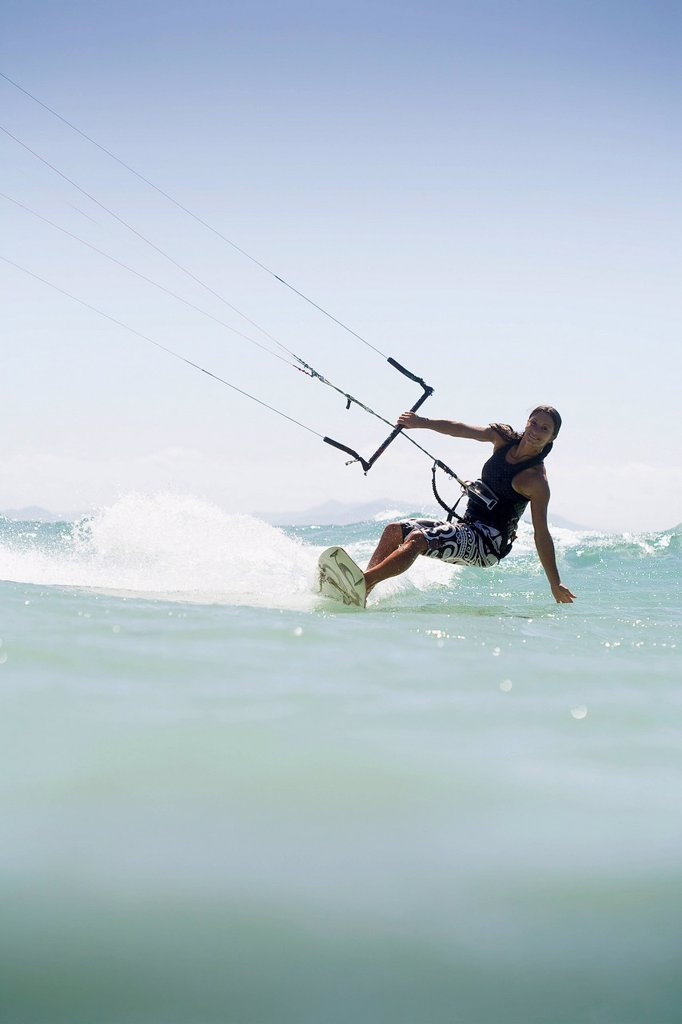 Woman kitesurfing in costa de la luz, tarifa, cadiz, andalucia, spain : Stock Photo