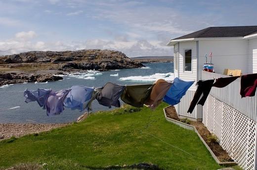 Laundry drying on the clothesline along the coast, fogo island, newfoundland, canada : Stock Photo