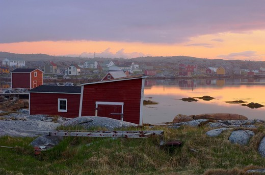 Fishing village along the water´s edge at sunset, fogo island, newfoundland, canada : Stock Photo