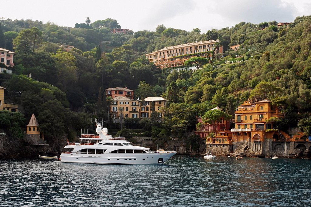 Stock Photo: 1889-83952 A Yacht Mooring In The Water With Residential Buildings Along The Water´s Edge, Italy
