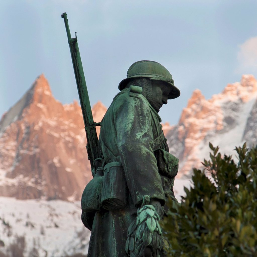 Statue Of A War Soldier With The French Alps In The Background, Chamonix_Mont_Blanc Rhone_Alpes France : Stock Photo