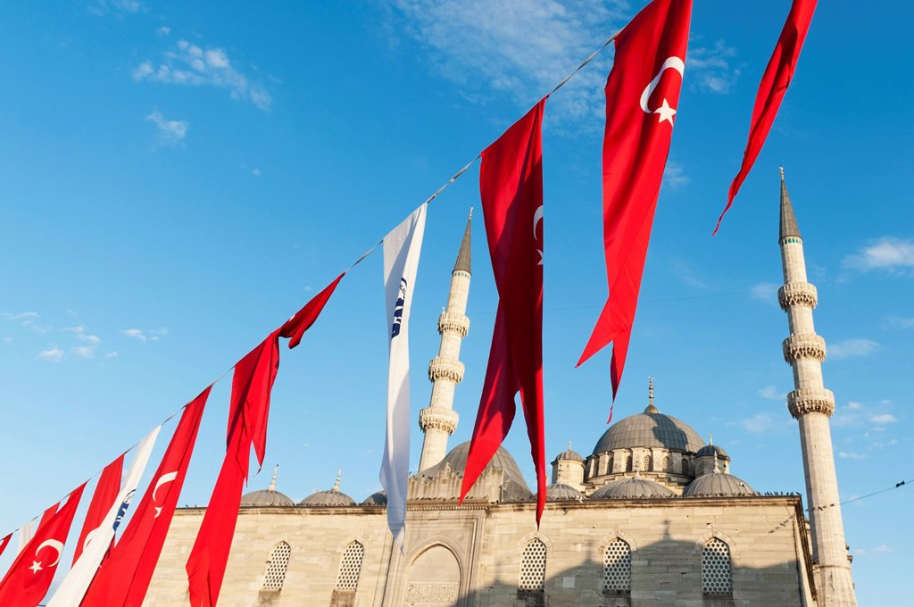 Stock Photo: 1889-84238 Flags Flying In Front Of The New Mosque, Istanbul Turkey